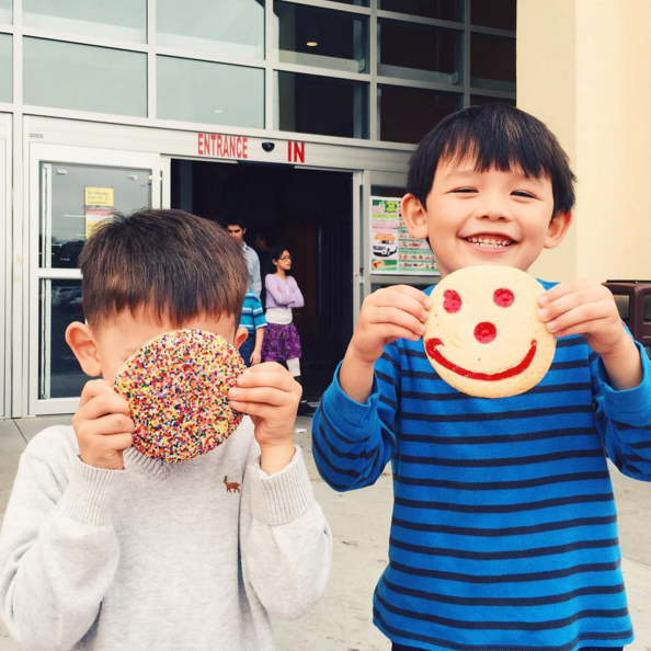 Two young Strong Citizens enjoy a treat from their local bakery. Photo courtesy of We Love BuHi.