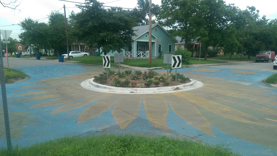 A colorful traffic circle/garden