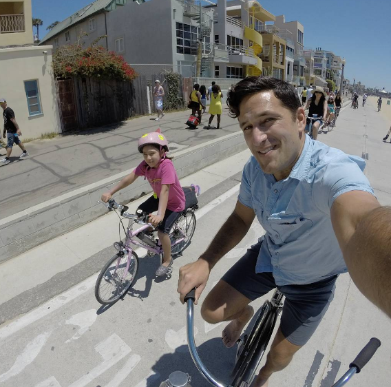 Joe and his daughter biking on Father's Day