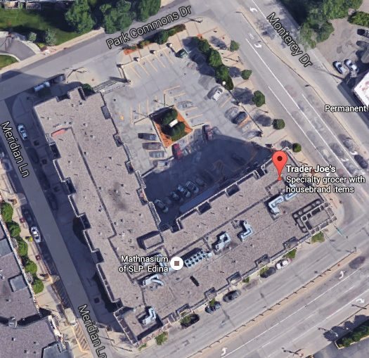 The bottom of the L is actually the only part of this building that Trader Joe's occupies. The top portion and the floors above the TJ's are all residential units. (Explore the site on GoogleMaps)