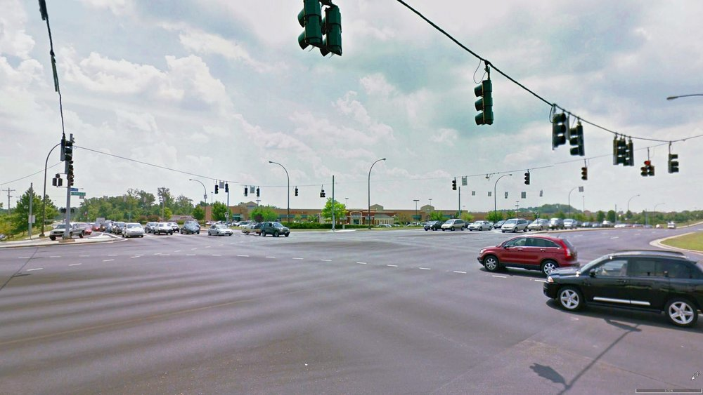 The intersection of North Fairfield Road and Pentagon Boulevard is the primary intersection within the Fairfield Crossing shopping center. The space is designed solely to satisfy the needs of automobiles. (Image from Google Earth)