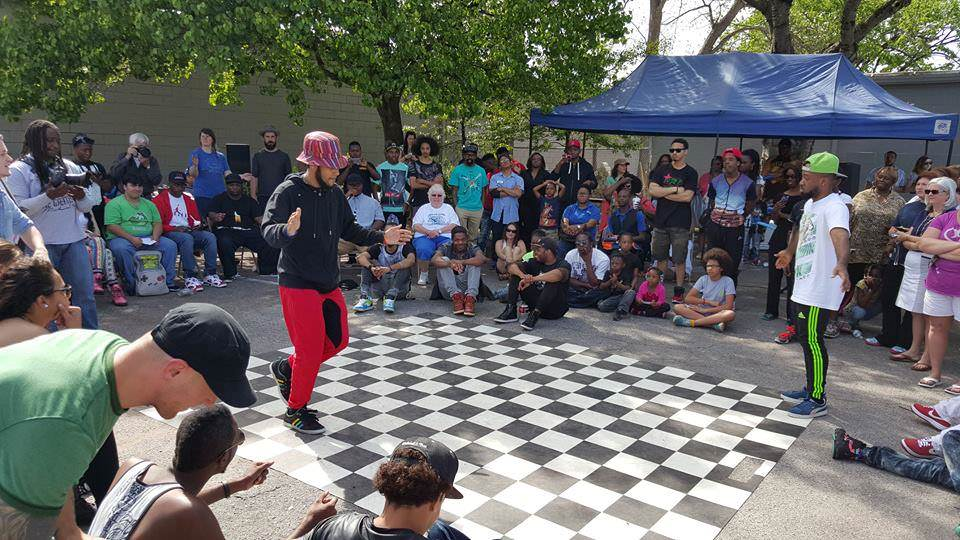 To add a little variety to the market, a breakdancing contest is held nearby. As you can see, it draws a crowd! (Photo from Woodlawn Street Market)
