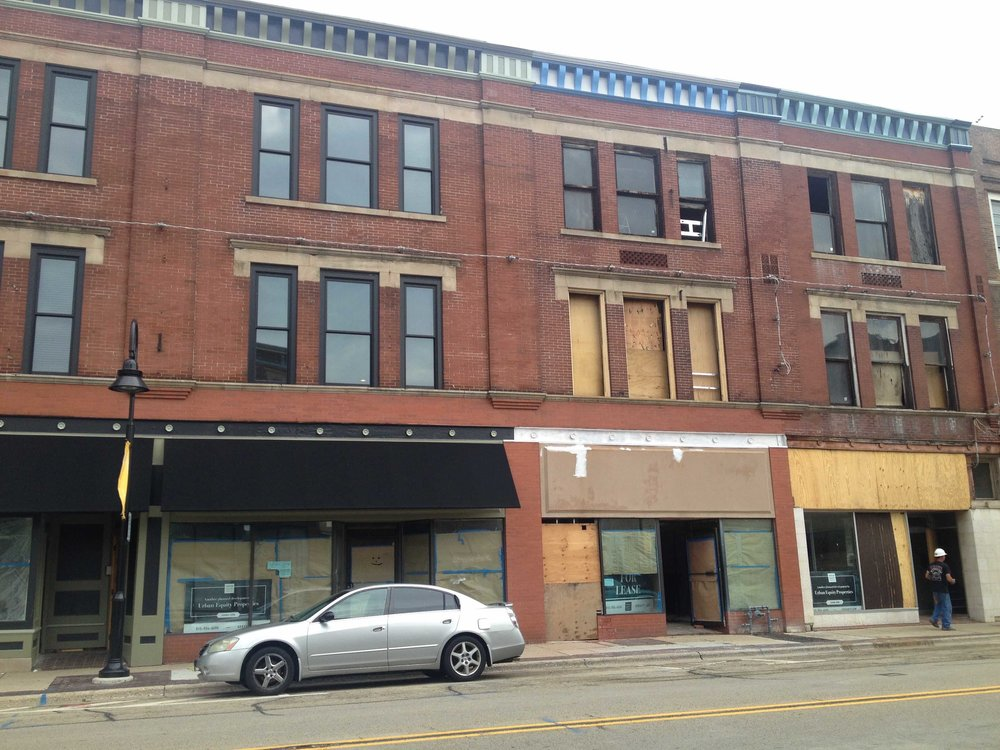 A mixed-use building in Midtown is being renovated and turned into apartments/commercial space. The left side with black awnings is the finished product. The right side with boarded windows is in process. This project is not owned by ZION Development but it's clear that their initiative has encouraged other developers to get to work improving the neighborhood.
