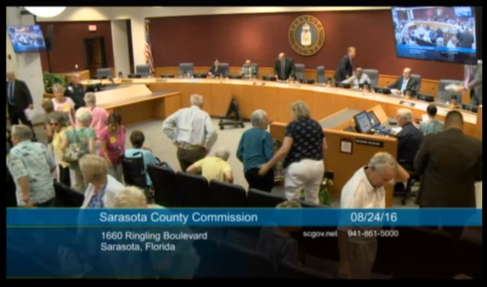 Residents stand up at the end of the public hearing. Source:  Sarasota County Commission