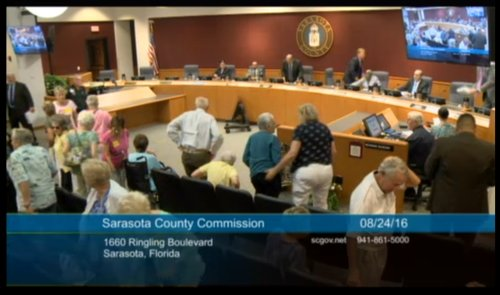 Residents stand up at the end of the public hearing in Sarasota, FL.  Read Daniel Herriges essay on NIMBYism and neighborhood concerns.