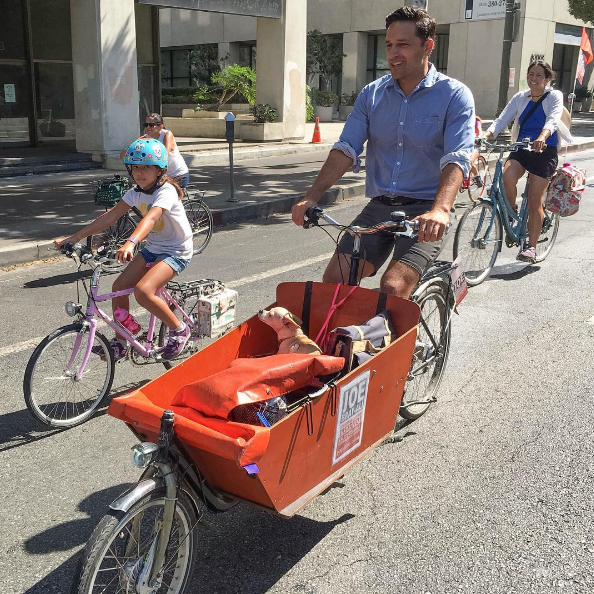 Joe bikes with his daughter (left) and chihuahua in CicLAvia 2016 (Photo from Instagram)