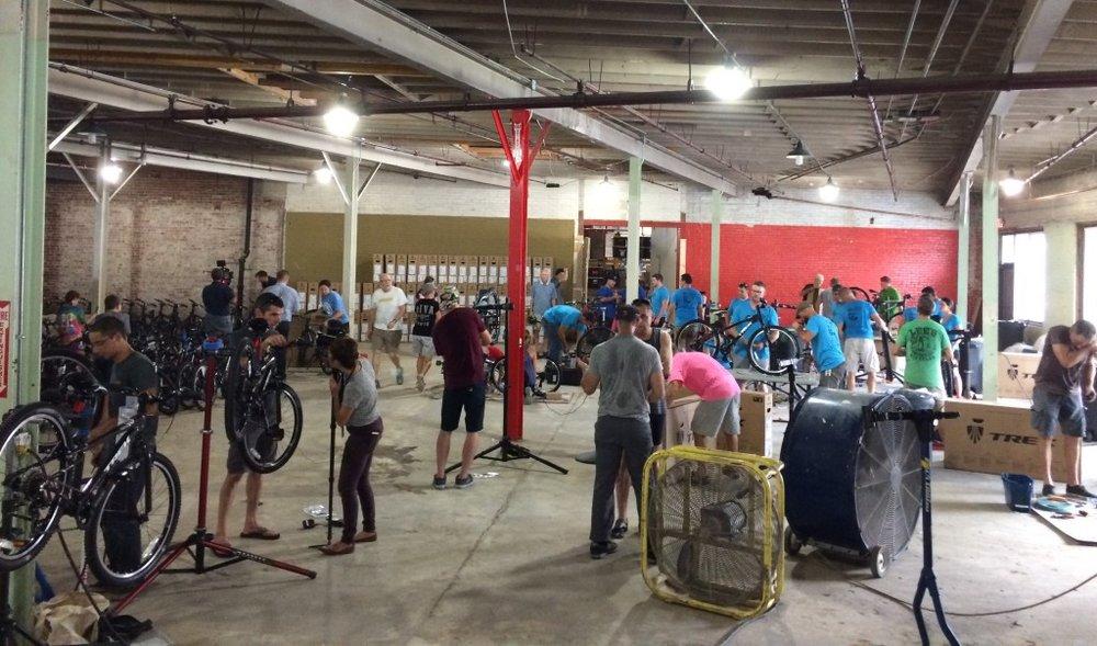 Volunteers assemble bikes for Bike Club - Photo by Sarah Kobos