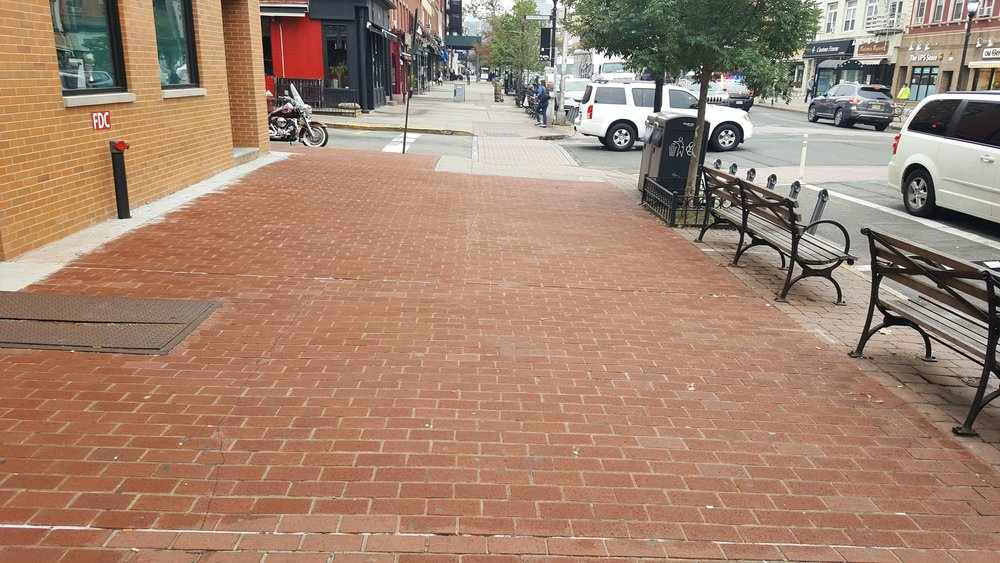 A recently paved brick sidewalk along Washington Street.