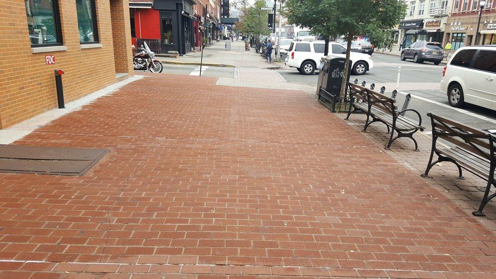 A recently paved brick sidewalk along Washington Street.