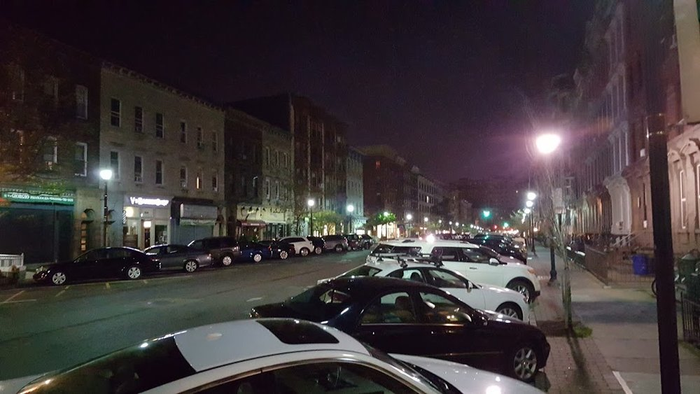 Washington St (Hoboken's main street) at 5:51am. No shops are open, yet every parking space is full. Clearly not benefiting the businesses.