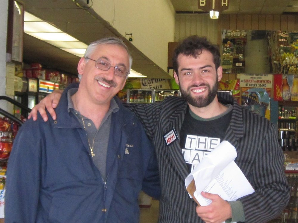 Local grocery store owner Sam (with me on the right) embraced our street events once we found ways to help his business through the events.