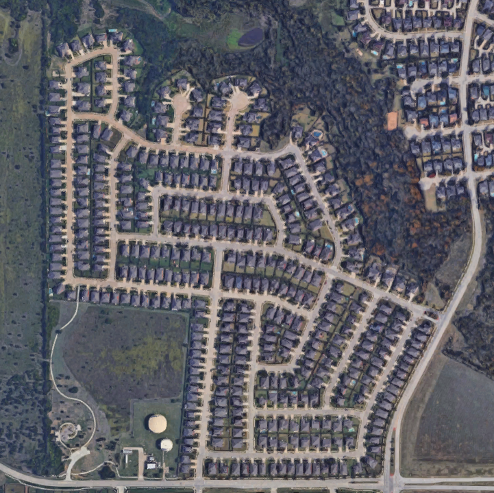 For comparison: my old neighborhood. Very little within walking distance, and no tree canopy in the neighborhood. (Image from google earth)