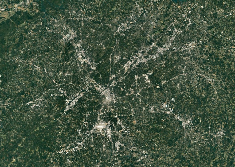 Atlanta metropolitan area, current-day satellite photo from Google Maps. City size determined by 30-minute driving distance.