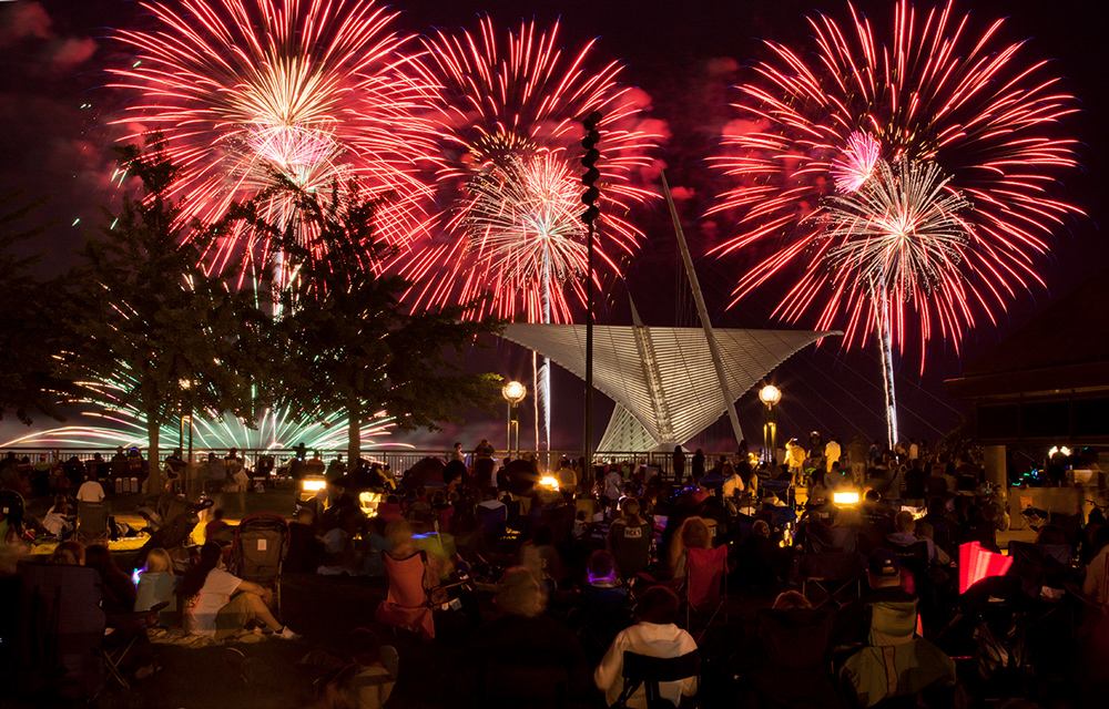 Parks aren't just for playing or walking. They're also a location for community events. In this photo, O'Donnell Park provides a venue for viewing the annual Independence Day fireworks over Lake Michigan in Milwaukee, WI. You can also see another public amenity in this photo - the Milwaukee Art Museum.