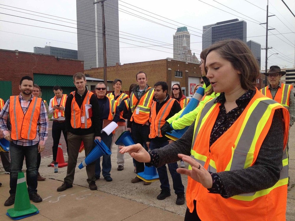 Marielle Brown (front, right) preps a group of Summit attendees to participate in a traffic calming demonstration. Daniel Herriges is pictured far left.