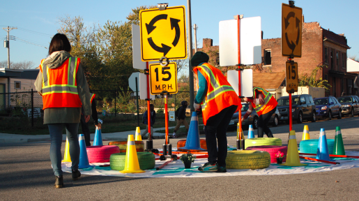 Trailnet sets up a mini roundabout for a traffic calming demonstration (Source: Trailnet's How-to Guide for Pop Up Traffic Calming)