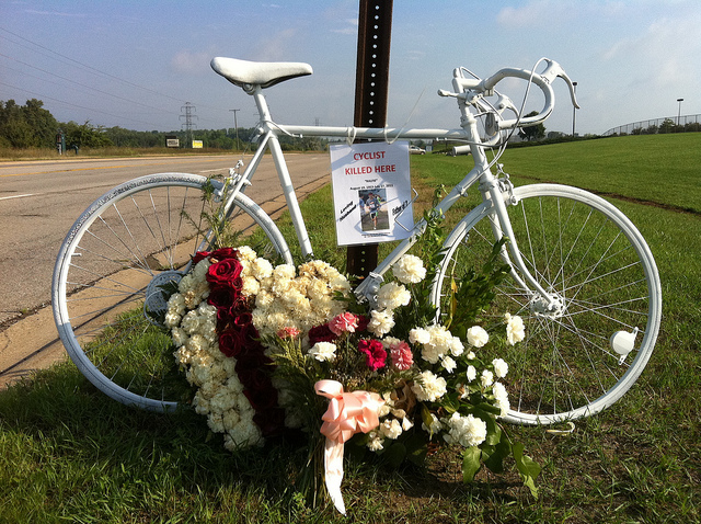 """A """"ghost bike"""" honoring and acknowledging the death of a cyclist at this location. (Source: Rory Finneren)"""