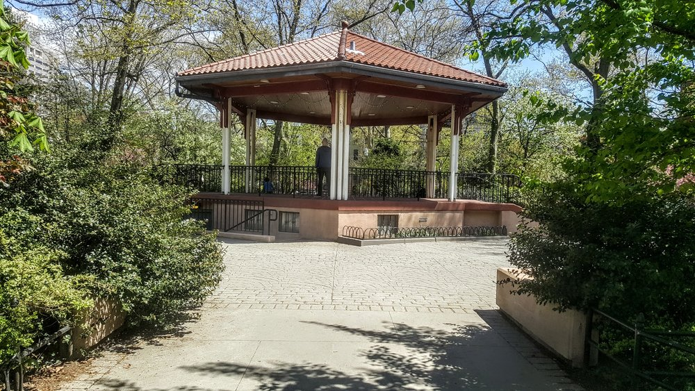 The gazebo in the middle of the park.