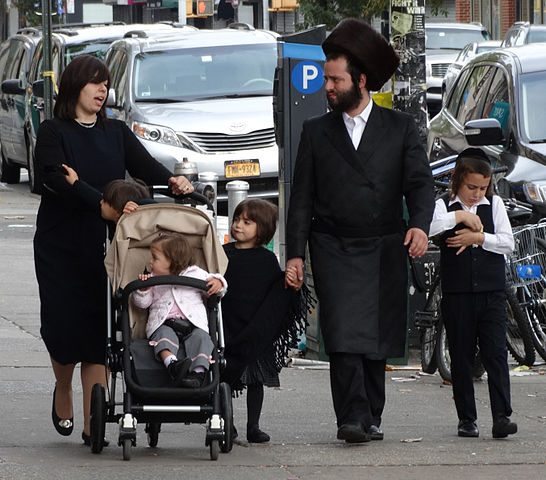 Hasidic family in Borough Park, Brooklyn. The hasidim are an Orthodox Jewish sect. (Photo by Adam Jones)