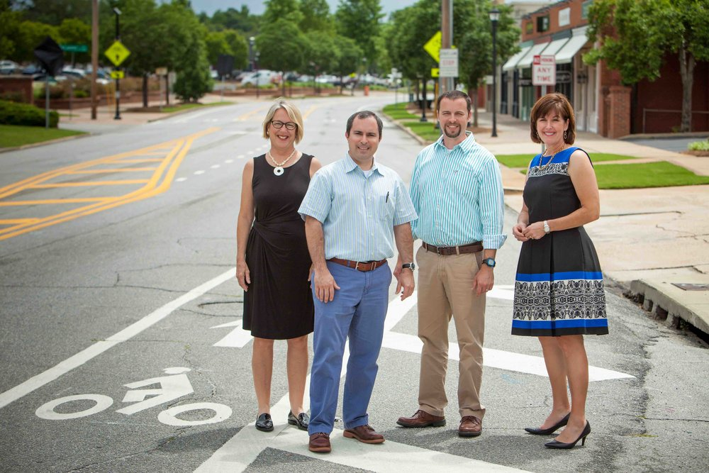 The team that led the 13th street redesign: Anne King (Midtown, Inc.), Will Burgin (Jackson Burgin, Inc)., Tyler Peek – Georgia Department of Transportation, and Betsy Covington (Community Foundation of the Chattahoochee Valley, Inc.). Not pictured: Donna Newman (City of Columbus, Engineering Department Director). Photo by Ritchie White.