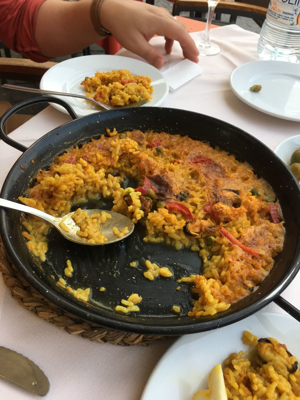 Enjoying a Spanish classic—paella—at an outdoor cafe