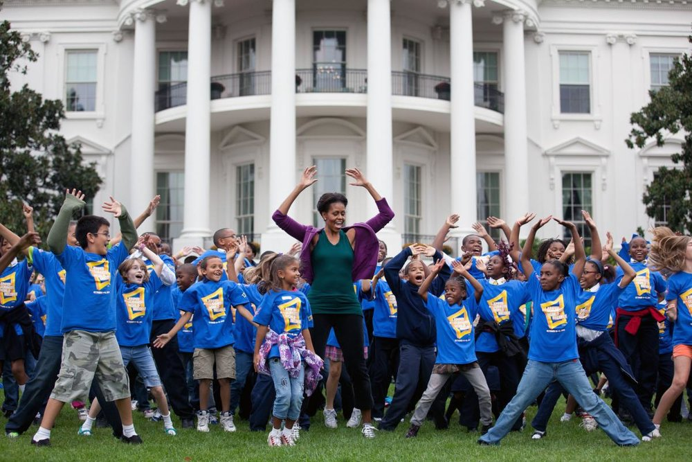 First Lady Michelle Obama exercises with children in front of the White House as part of the Let's Move! campaign. (Official White House Photo by Chuck Kennedy)