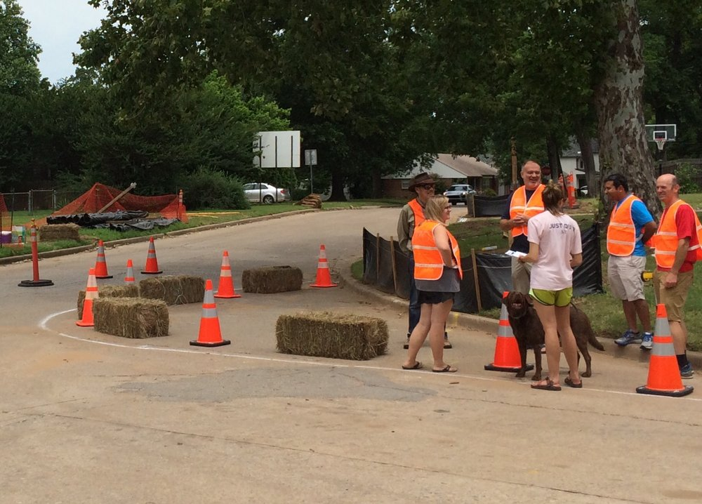 Members of Tulsa's Bicycle Pedestrian Advocacy Committee working with neighbors on a traffic calming exercise. (Photo by Sarah Kobos)