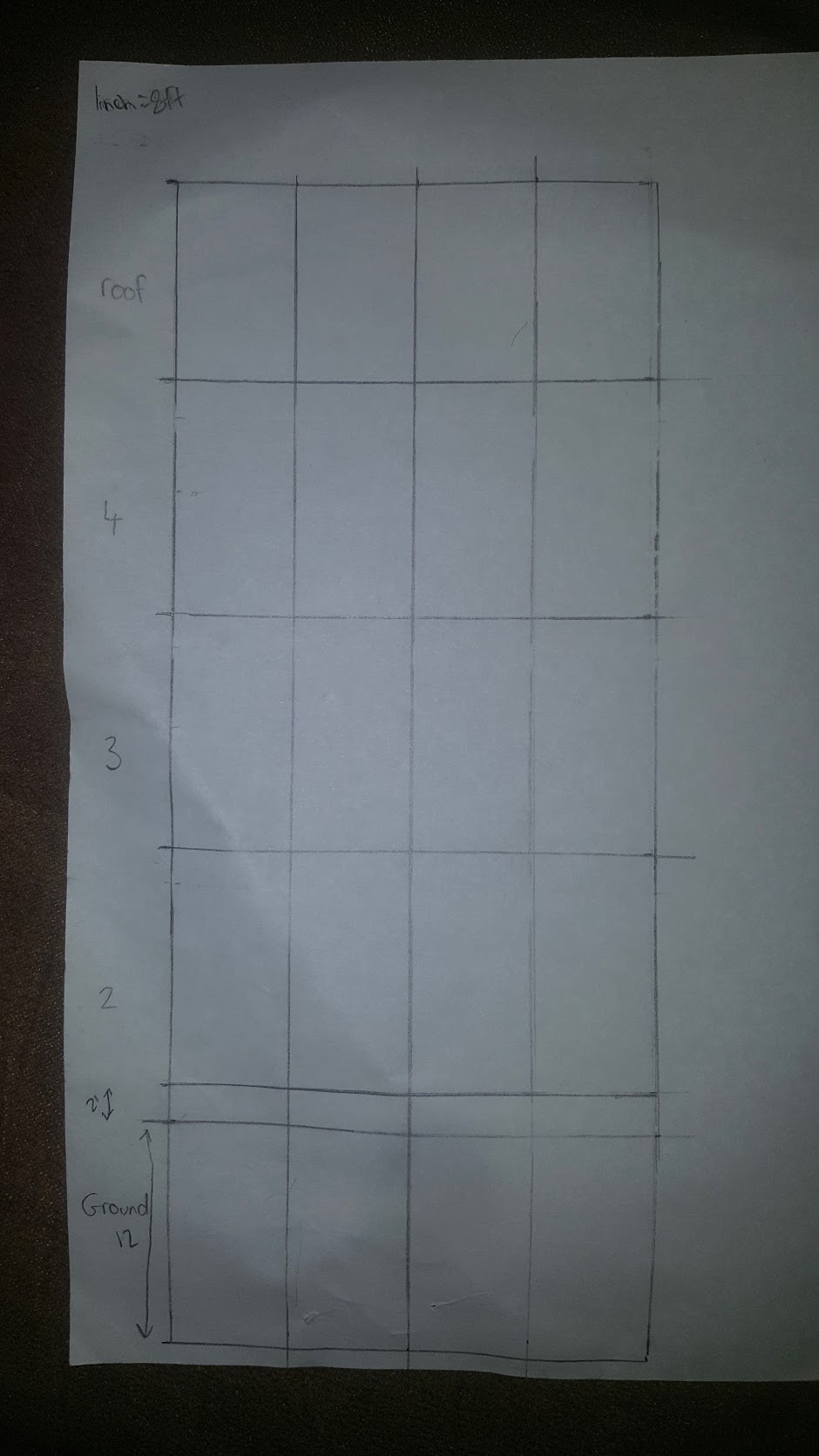 The 25x60 foot front side of my building with guidelines dividing the floors and placement of the doors and windows.