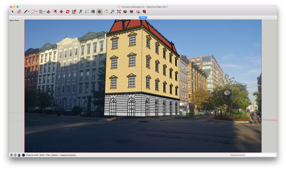 My model imposed over the the vacant lot in the SketchUp editor.