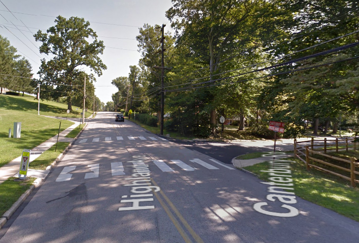 The road where the crash took place. Notice the painted crosswalk and crossing signs... But also notice the lack of on-street parking or points of interest on the side of the road, and the large corner radius, all of which encourage speeding. (Source: Google Earth)