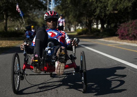 A military veteran uses an adaptive bicycle. (Source: U.S. Air Force photo/ Senior Airman Dennis Sloan)