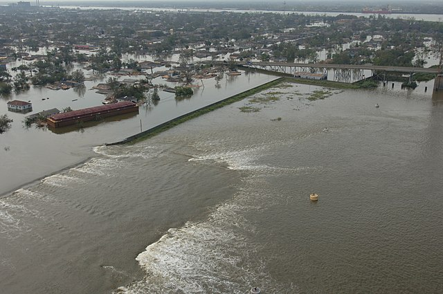 A levee breaks during Hurricane Katrina in New Orleans. (Source: FEMA)