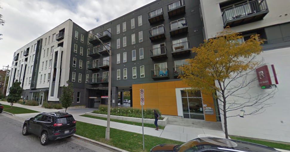 The Standard apartments. The library entrance is just to the right of the orange segment of the building. (Source: Google Maps)