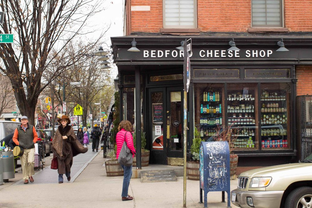 A textbook image of gentrification: cheese shop in Willamsburg, Brooklyn. (Source: Wikimedia Commons)