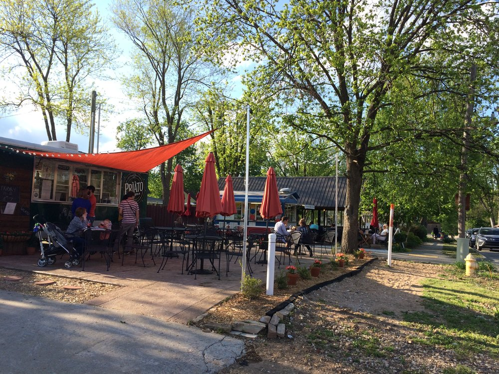 Canopies and umbrellas welcome folks in Bentonville, AR (Photo by Sarah Kobos)