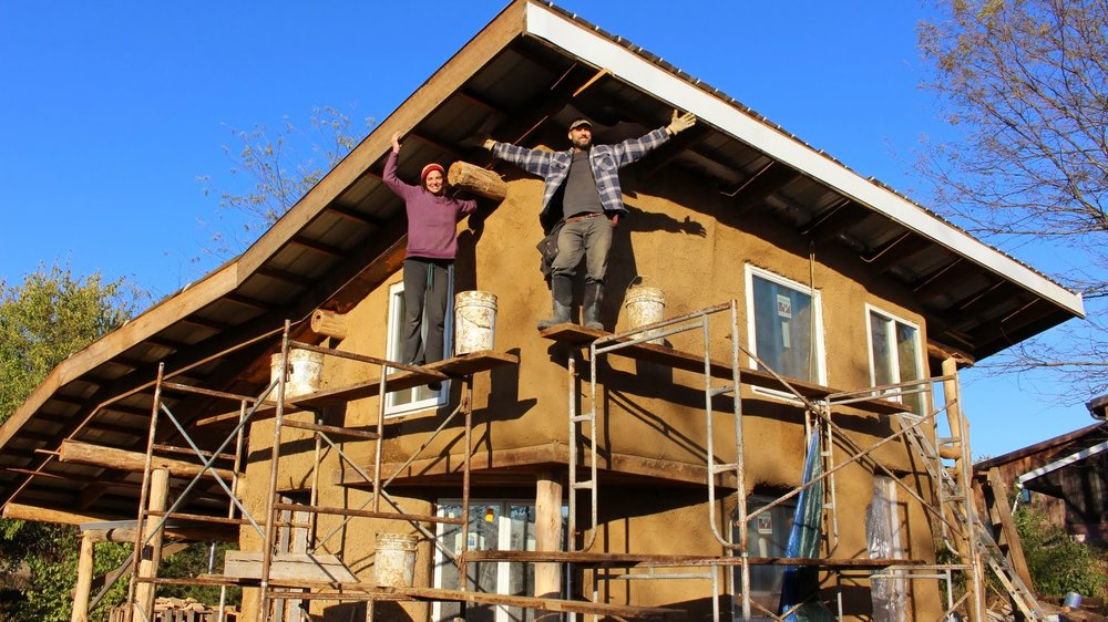 Community members display the house they've been building. (Source: Dancing Rabbit Facebook page)