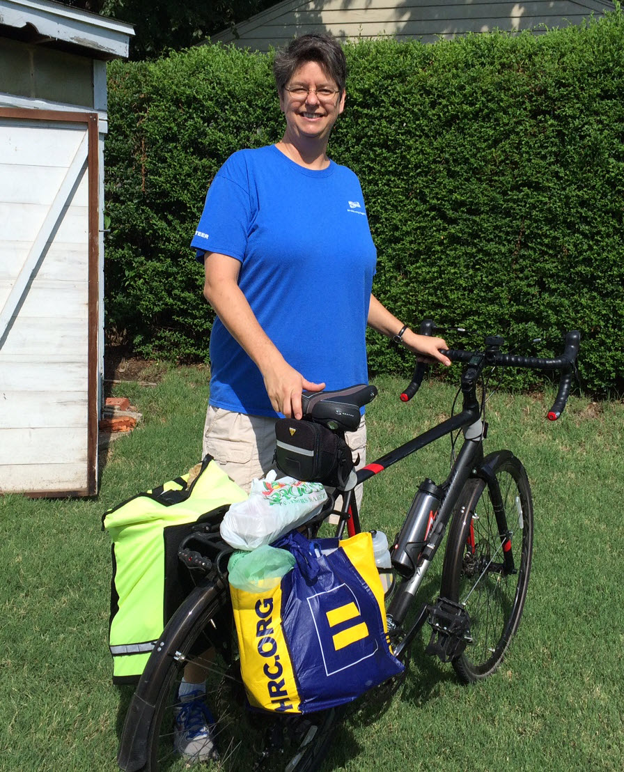 The author, back from the store, with eggs on the rear rack.  (Photo by Cathy Wiedenhoeft.)