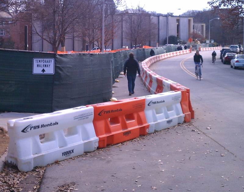 Simple barriers create safe space for people to walk near a construction zone after sidewalk space is closed off. (Source: Yodock.com)