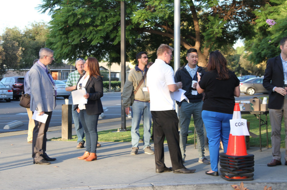 Advocates in Santa Ana, CA discuss local street issues at a Strong Towns walking tour (Source: AHOC)