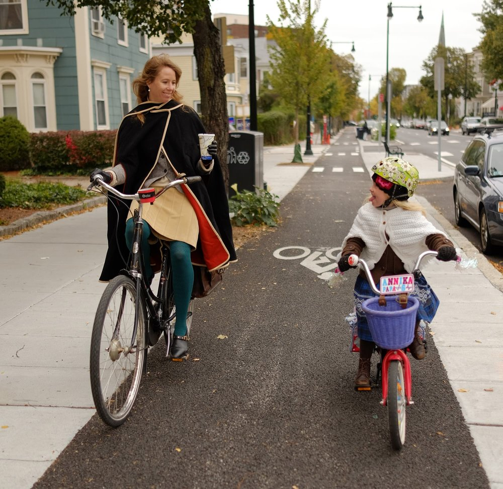 Megan Ramey and her daughter Annika ride on a protected bike lane in Boston. (Credit: Kyle Ramey)