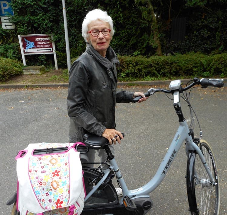 A woman shows off her practical, easy to ride electric bike (Source:  electricbikeblog.com )