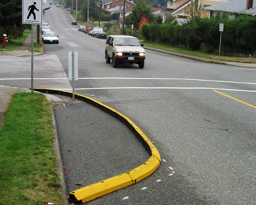 A temporary, inexpensive traffic calming measure that probably took enormous political will to actually implement. (Source: Wikimedia Commons)