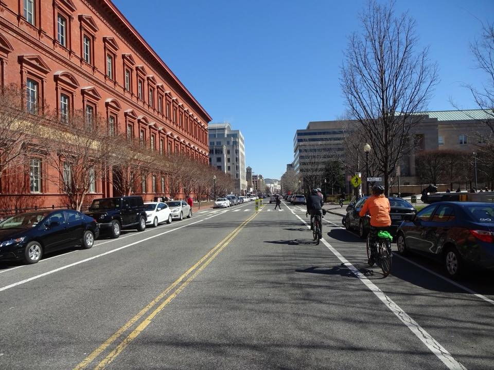When this photo was posted in the Facebook group, commenters discussed the merits and drawbacks of the bike lane, applauded the mid-block pedestrian crossing, and commented on the surprising lack of traffic for such a wide street.