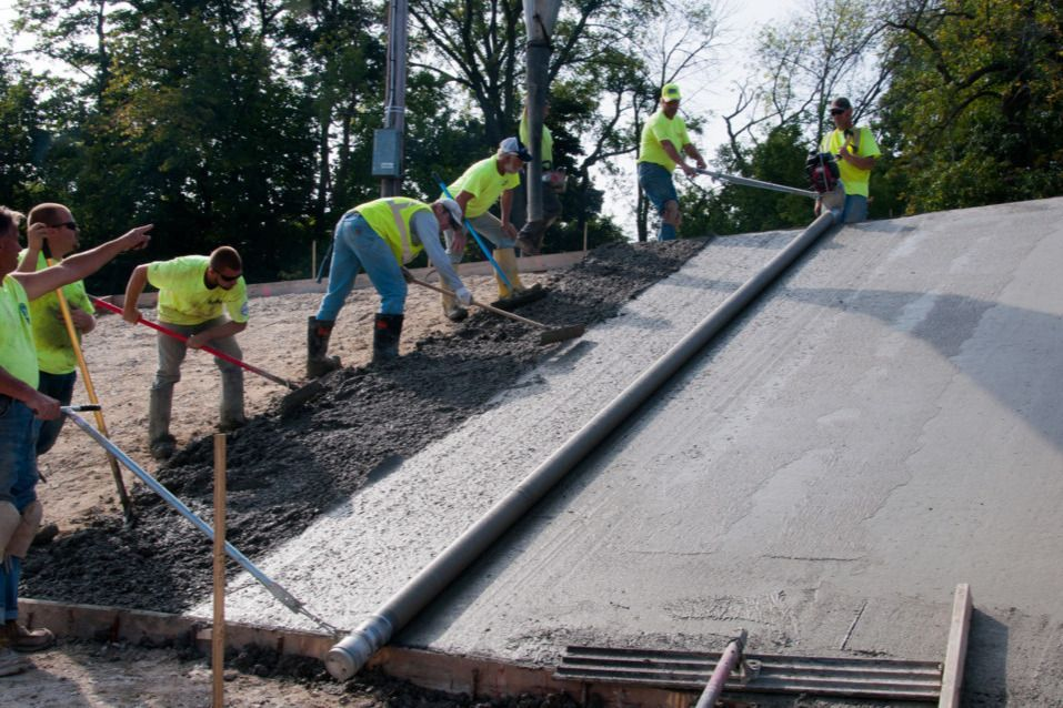 Volunteers work to restore velodrome paving (Source: Penrose Park GoFundMe page)