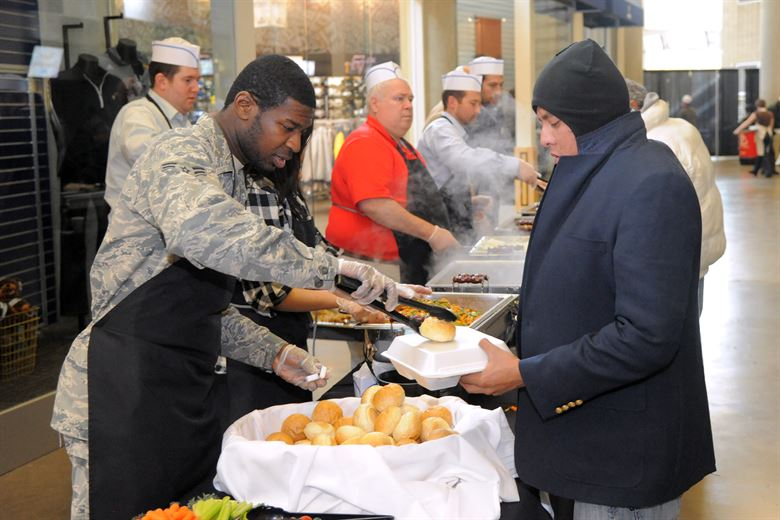 Utah residents in need receive a hot meal on Thanksgiving (Source: U.S. Air Force photo by Todd Cromar)