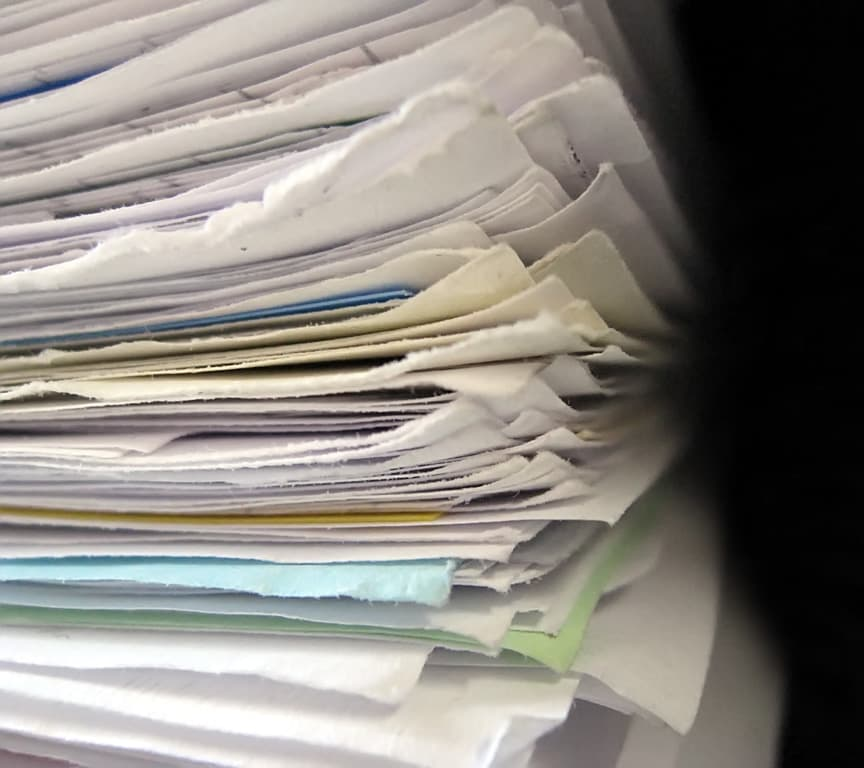 If your city requires a stack of papers this thick just to get approval for a simple addition on a home or business, something is wrong. (Source: Niklas Bildhauer)