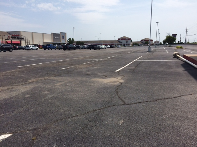 The stores are all open, but where are the cars? Minimum parking requirements waste space in commercial shopping centers. (Photo by Sarah Kobos)