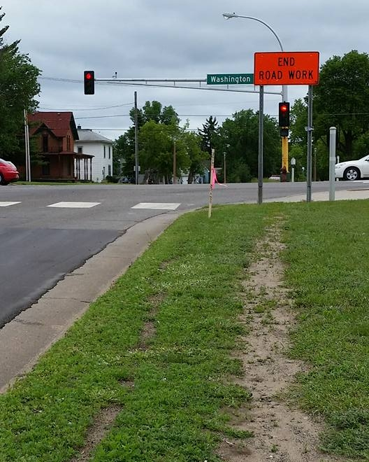 A worn path in the grass suggests desperate need for a sidewalk. What a simple fix.