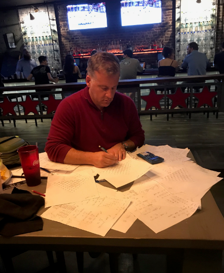 Noah at work on the Schiffman Equation in a Charleston bar, May,2018