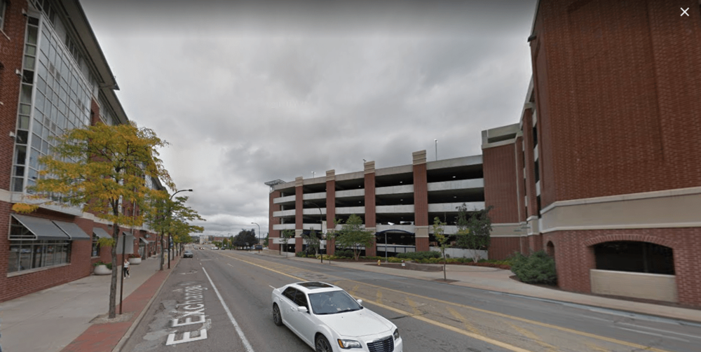 Large auto-oriented university dorms and parking ramps flank this fast-moving stroad with little in the way of street-level activity or life. (Source: Google Maps)